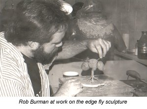 Rob Burman works on the edge fly sculpture