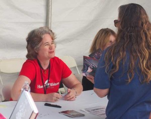 Lisa signing books and chatting with readers at the LA Times Festival of Books, 4/13/14